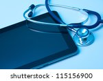 Doctor workplace with digital tablet and stethoscope. Application of modern technology in medicine concept. You may place your own screen, for example web page on tablet screen. - stock photo