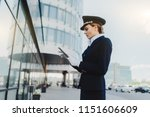 girl pilot looks at the tablet... | Shutterstock . vector #1151606609