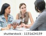 businesswomen discuss in the... | Shutterstock . vector #1151624159