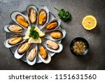 seafood mussels with lemon and... | Shutterstock . vector #1151631560