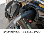 electric vehicle being charged... | Shutterstock . vector #1151631920