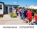Small photo of Cape Elizabeth, ME, USA August 13, 2013 A long line forms at lunch time at a popular Lobster Shack in Cape Elizabeth, Maine