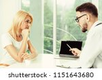 male doctor is talking to... | Shutterstock . vector #1151643680