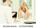 male doctor is talking to... | Shutterstock . vector #1151643686