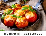 tomatoes stuffed with rice and... | Shutterstock . vector #1151658806