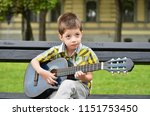 child boy playing on guitar in...   Shutterstock . vector #1151753450