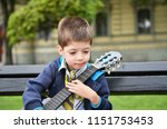 child boy with a guitar in a...   Shutterstock . vector #1151753453