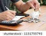 saving money concept man hand...   Shutterstock . vector #1151755793