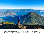 hiker with panorama view of... | Shutterstock . vector #1151761919