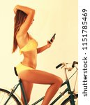 sexy girl on bike with... | Shutterstock . vector #1151785469