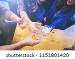group of friends clinking the... | Shutterstock . vector #1151801420