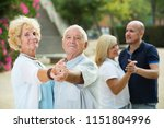 smiling senior parents with... | Shutterstock . vector #1151804996