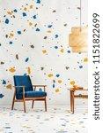 navy blue armchair next to...   Shutterstock . vector #1151822699