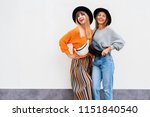 two  exited hipster women... | Shutterstock . vector #1151840540