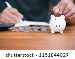 saving money concept man hand...   Shutterstock . vector #1151844029