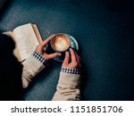 woman holding a coffee cup and... | Shutterstock . vector #1151851706