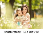 mother and daughter in the park | Shutterstock . vector #115185940