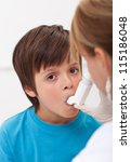 Emergency assistance for a child with respiratory problems - using an inhaler - stock photo