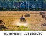 the couple is riding a quad... | Shutterstock . vector #1151865260
