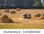 the couple is riding a quad... | Shutterstock . vector #1151865263