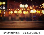 image of wooden table in front... | Shutterstock . vector #1151908076