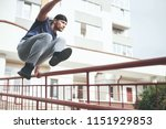 young sports man doing parkour... | Shutterstock . vector #1151929853