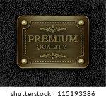 metal badge on black leather...
