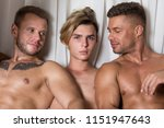three sexy guys are resting in... | Shutterstock . vector #1151947643