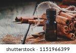essential cinnamon oil in a... | Shutterstock . vector #1151966399