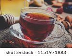 black tea in a glass cup with... | Shutterstock . vector #1151971883