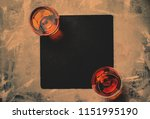 cognac in two glasses on stone... | Shutterstock . vector #1151995190