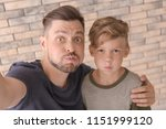 little boy with his dad taking...   Shutterstock . vector #1151999120