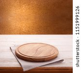 wooden table with empty board... | Shutterstock . vector #1151999126