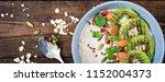 healthy breakfast. oatmeal with ... | Shutterstock . vector #1152004373