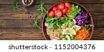 vegetarian buddha bowl with... | Shutterstock . vector #1152004376