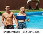 couple with bottles of beer... | Shutterstock . vector #1152048536