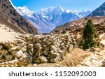 stone fence in mountains.... | Shutterstock . vector #1152092003