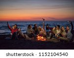 a group of friends using cell... | Shutterstock . vector #1152104540