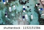 yachts and boats in the bay.... | Shutterstock . vector #1152151586