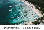 yachts and boats in the bay.... | Shutterstock . vector #1152151589