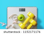 fruit  dumbbell and scale  fat... | Shutterstock . vector #1152171176