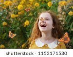 laughing curly girl with a... | Shutterstock . vector #1152171530