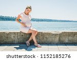 pregnant woman sitting close to ... | Shutterstock . vector #1152185276