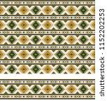 seamless geometric ethnic... | Shutterstock .eps vector #1152202253
