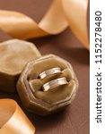 Small photo of Two-tone wedding rings in velvet jewelry box. Rose gold and silver rings in brown gift box