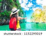 active traveler asian girl joy... | Shutterstock . vector #1152295019