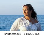 beautiful woman with a flower... | Shutterstock . vector #115230466