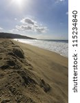 An Almost Empty Shoreline With...