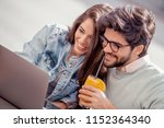 young couple spending time in... | Shutterstock . vector #1152364340