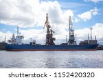 large cargo ship in port during ... | Shutterstock . vector #1152420320